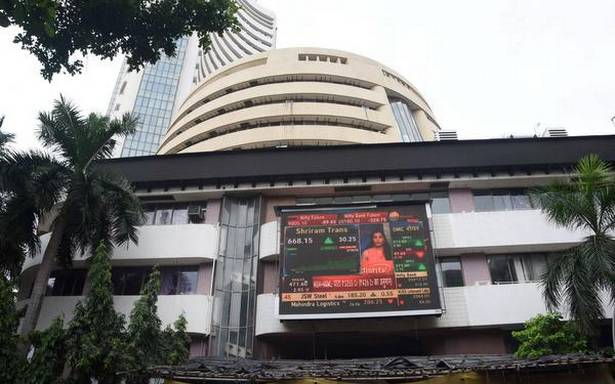Sensex slips 97 points; Nifty gives up 9,900 level