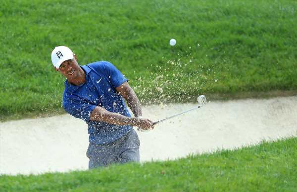 Par Putt Gets Tiger Woods to the Weekend at Memorial