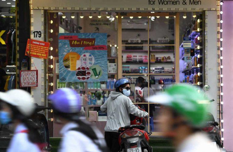 Vietnam reports first coronavirus deaths after months of successful curbs
