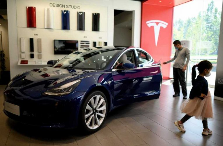 Stocks making the biggest moves in the premarket: Tesla, Disney, Peloton, Wells Fargo & more