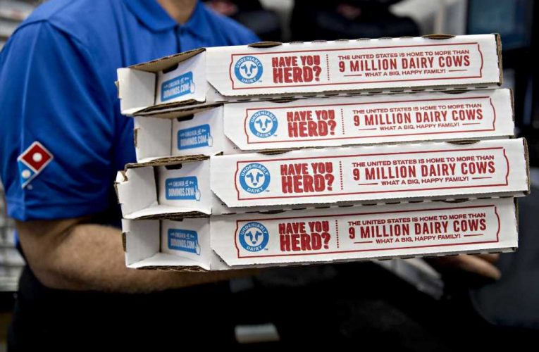 Domino's quarterly sales surge but pandemic costs hit earnings; shares tumble
