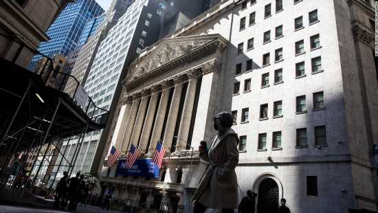 Dow plunges as coronavirus cases reach record numbers