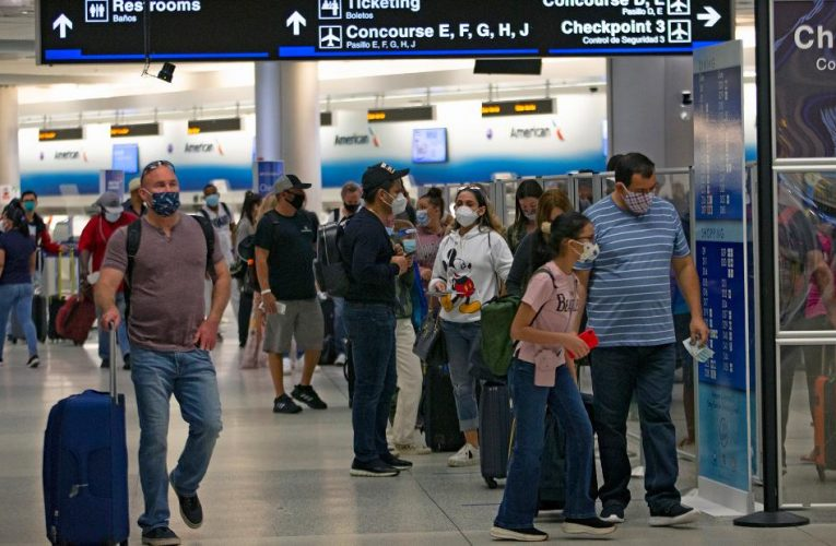 Millions travel for Thanksgiving despite Covid-19 surge