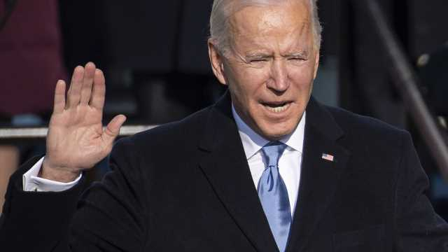 Unlike Trump, Biden in no rush to file for re-election