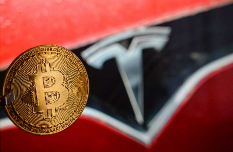 Bitcoin hits another record high after Tesla's $1.5 billion buy-in
