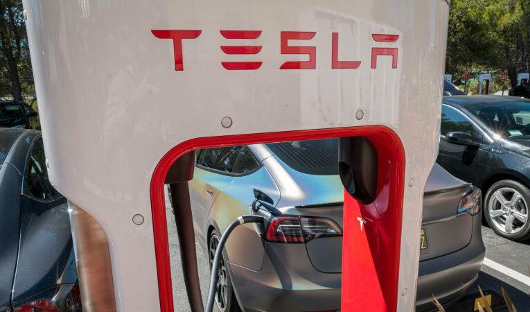 Tesla posts $561m profit as sales double