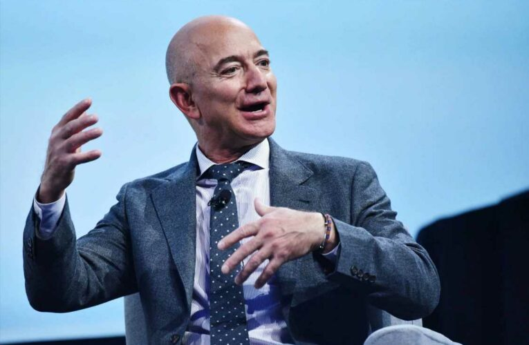 Jeff Bezos reaches space on Blue Origin's first crewed launch